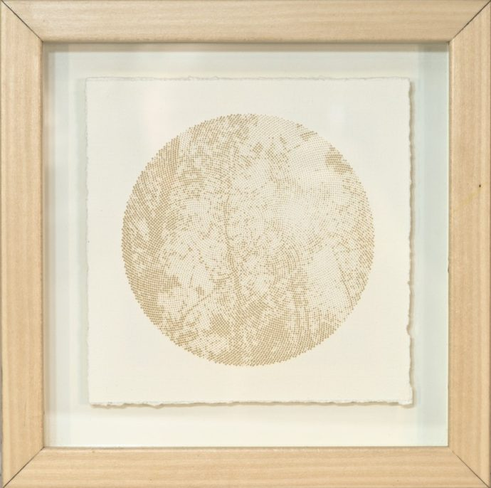 Laser etched image of trees on hand made paper.